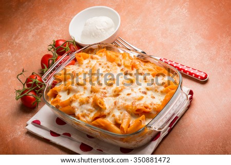 oven pasta pizzaiola with tomato and mozzarella - stock photo