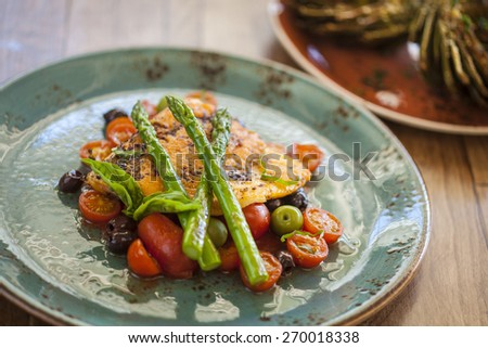 oven-roasted Arctic char with asparagus, tomatoes and olives and grilled artichokes appetizer