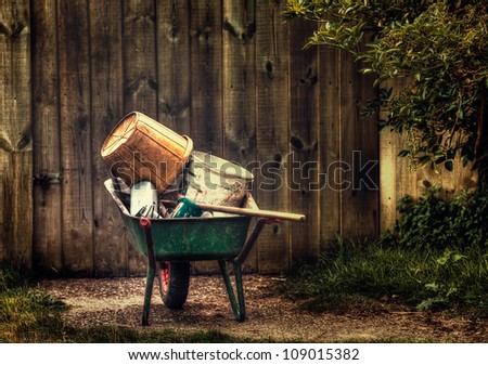 over flowing wheel barrow - stock photo