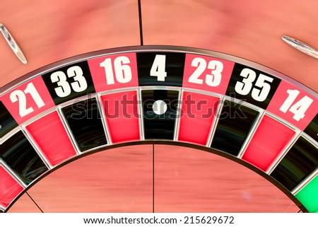 Over head sot of an American roulette wheel winning number four - stock photo