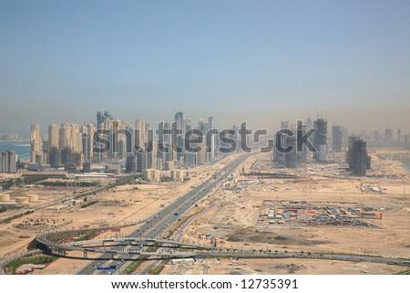 Over look New City of Dubai Constructing in Desert - stock photo