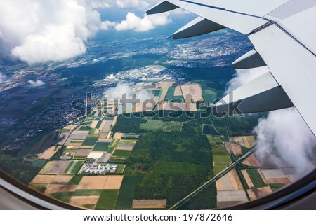 over rural landscape, view during a flight over fields and forest - stock photo