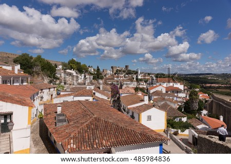 Over the roofs of the old town of Obidos, a medieval town in Portugal