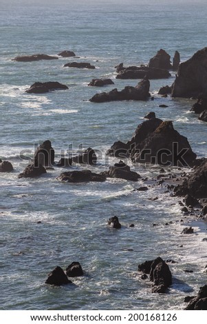 Over time Pacific storms have worn Northern California's coastline into dramatic scenery. Eroded rocks, called sea stacks, form impressive vistas that can be viewed from the Pacific Coast highway. - stock photo