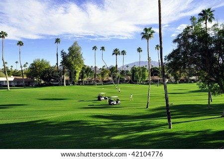over view of Golf cart on fairway - stock photo