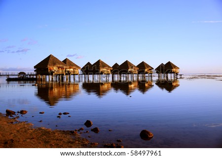 over water bungalow in the evening - stock photo