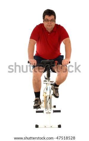 Over weight men working out in a static bicycle