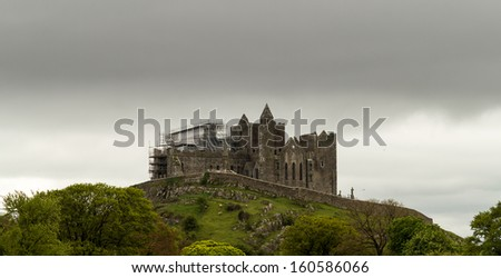 Overcast cloudy sky over the castle at Rock of Cashel under renovation and scaffolding - stock photo
