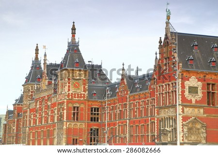 Overcast sky above the main railway station in Amsterdam, Holland  - stock photo