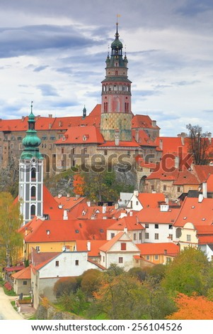 Overcast sky cover tall tower of a medieval castle from the historical town of Cesky Krumlov, Czech Republic - stock photo