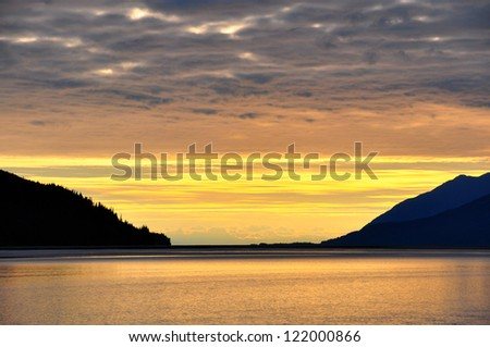 Overcast sky with Golden sunset at turnagain arm, Alaska. - stock photo