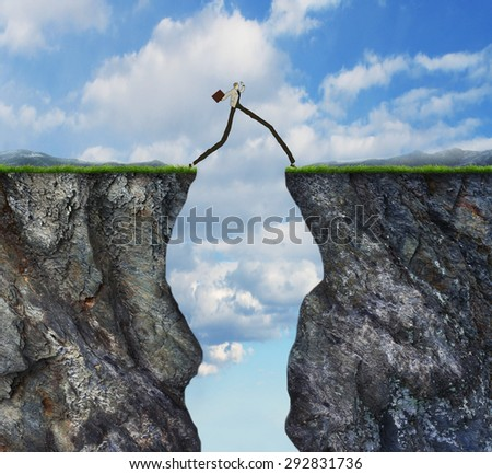 Overcoming obstacle concept as businessman with very long legs walking past through two high cliffs as success bridge metaphor to surmount obstruction solve problem - stock photo