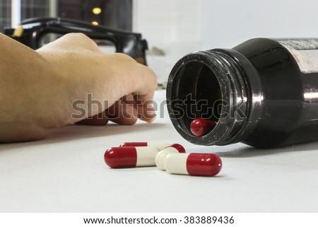 Overdose drug addict hand, drugs narcotic syringe on white background - stock photo