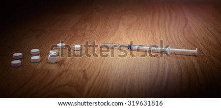 overdose female drug addict hand, drugs narcotic syringe on floor - stock photo