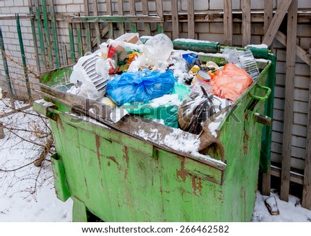 Overfilled trash dumpster from above view - stock photo