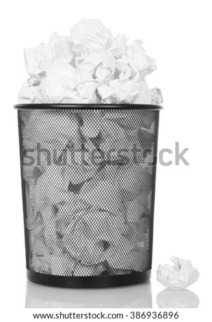 Overflowing metal trash bin from paper isolated on white background. - stock photo
