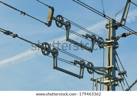 Overhead contact wires of electrified railway tracks kept under tension.  - stock photo