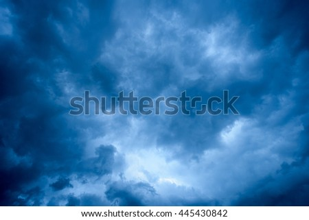 Overhead dark blue storm clouds and white areas and copy space for text overlays