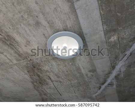 overhead LED light with movement sensor in parking garage