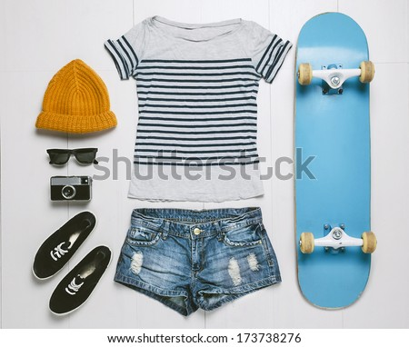 Overhead of essentials skater woman. Outfit of casual woman. - stock photo