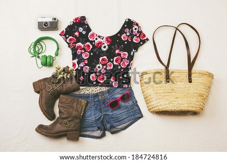 Overhead of essentials spring woman. Outfit of casual and modern woman.