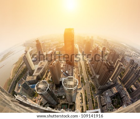 Overhead of the sunset over the city - stock photo
