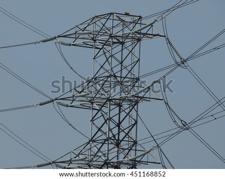 overhead power line with transmission tower,or power tower blue sky background