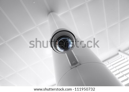 Overhead security camera in a government owned public building. - stock photo