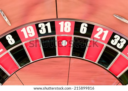 overhead shot of a American roulette wheel with a winning number eighteen - stock photo