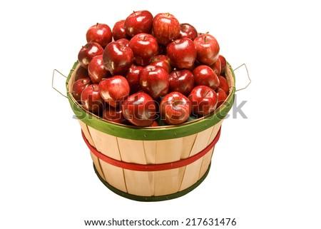 Overhead Shot of A Bushel Basket Full Of Red Apples On White Background - stock photo