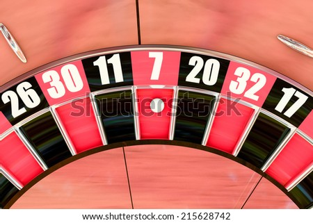 Overhead shot of an American roulette wheel winning number seven - stock photo