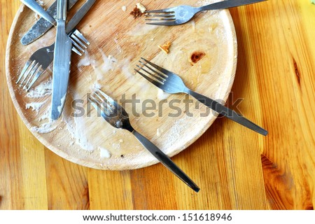 overhead shot of an empty dish on wood table - stock photo