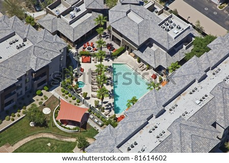Overhead shot of Apartment Units and Pool - stock photo