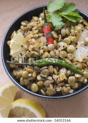 Overhead shot of Bowl of Green Lentils cooked with Sliced Lemon Chili and Coriander - stock photo