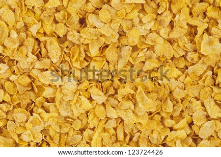 Overhead shot of pile of cereal flakes. - stock photo