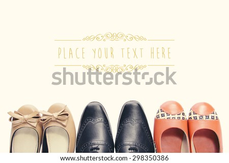 Overhead shot of three pairs of shoes tips in vintage style with copyspace - stock photo
