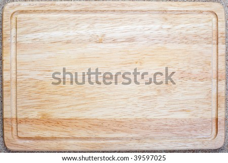 Overhead shot of wooden bread board perfect for backround - stock photo
