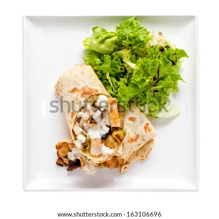 Overhead studio shot of tortilla wrapped chicken sandwich isolated on white - stock photo