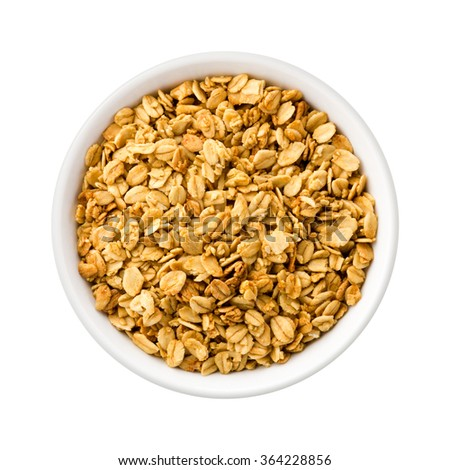 Overhead View Nutty Granola in a ceramic bowl. Rich in fiber and nutrition. The image is a cut out, isolated on a white background, with a clipping path. - stock photo