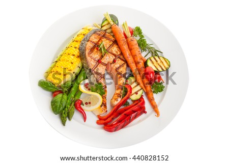 Overhead view of a grilled salmon steak with vegetables corn and asparagus - stock photo