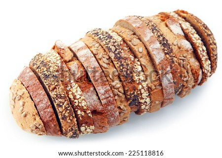 Overhead view of a loaf of artistic assorted types of bread sliced and arranged in a single loaf with different seeds, rye and wheat bread on a white background - stock photo