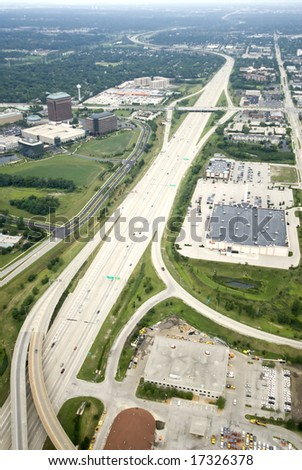 Overhead view of a long strip of expressway - stock photo