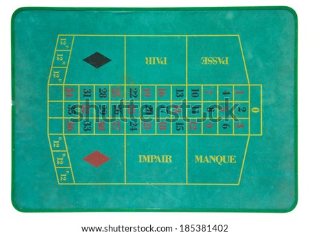 Overhead view of a vintage roulette board for placing bets on odd or even numbers in red or black against the position at which the ball will come to rest on the wheel - stock photo