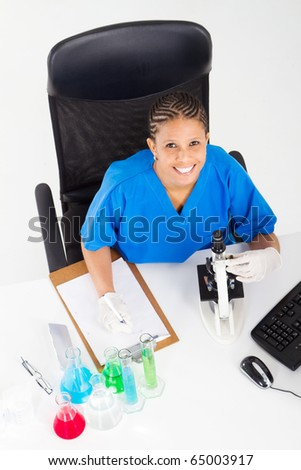 overhead view of african american lab technician worker in lab - stock photo