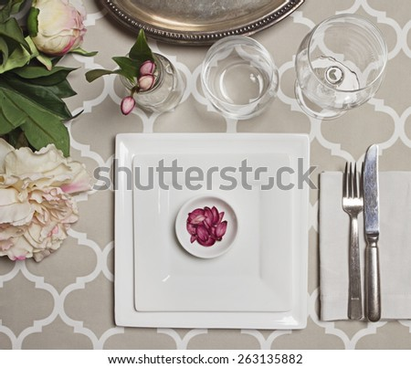 Overhead view of an elegant vintage moroccan wedding reception table setting - stock photo