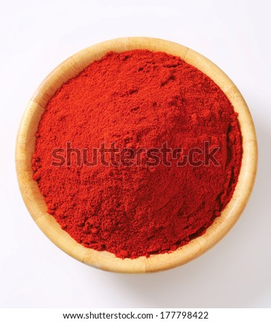 overhead view of bowl with ground chili peppers - stock photo