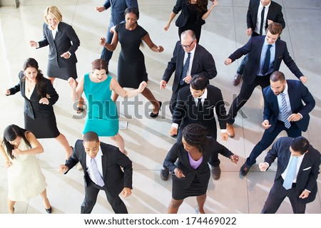 Overhead View Of Businesspeople Dancing In Office Lobby - stock photo