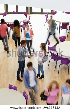Overhead View Of College Tutor Welcoming Student - stock photo