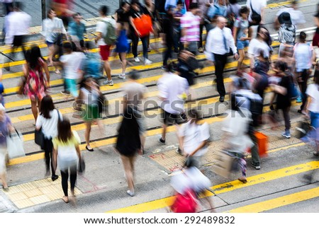 Overhead View Of Commuters Crossing Busy Hong Kong Street