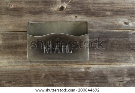 Overhead view of empty old metal mailbox on rustic wooded boards - stock photo
